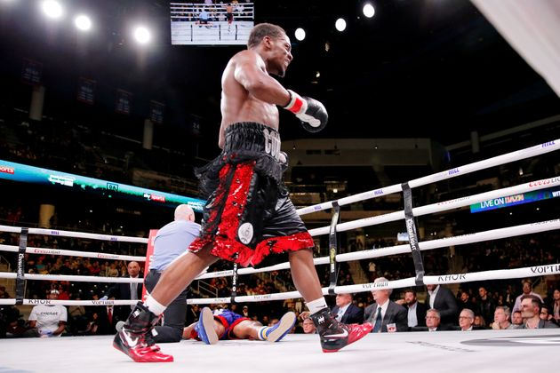 Oct 12, 2019; Chicago, IL, USA; Charles Conwell (black trunks) knocks out Patrick Day (red trunks) during...