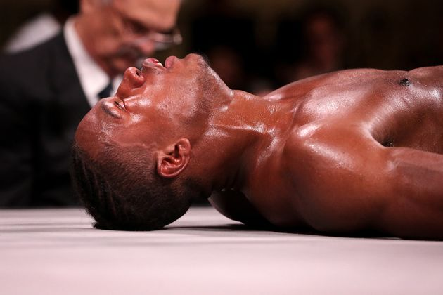CHICAGO, ILLINOIS - OCTOBER 12: Patrick Day lays on the mat after being knocked out by Charles Conwell...