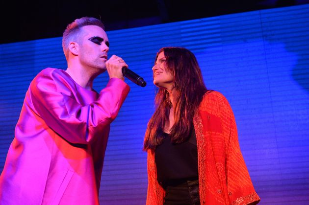 Justin Tranter (left) performs with Idina Menzel at the 2019 Spirit Day concert in Los