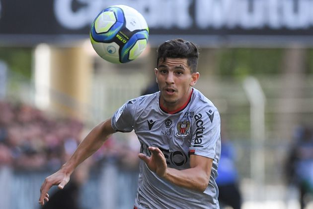 Nice's Algerian defender Youcef Atal eyes the ball during the French L1 football match Stade Rennais...