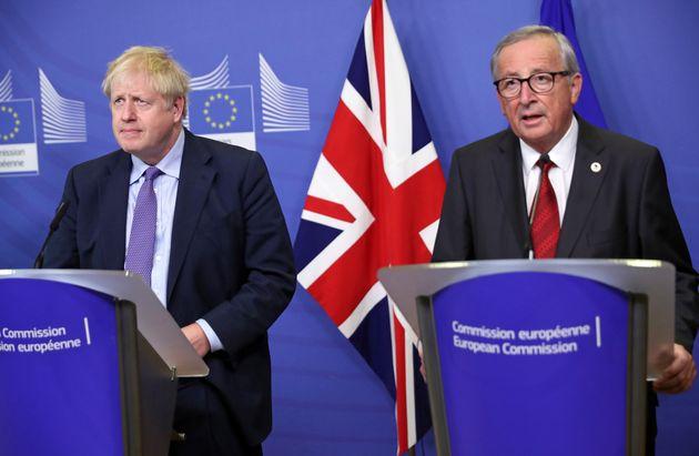 British Prime Minister Boris Johnson and European Commission President Jean-Claude Juncker make prepared...