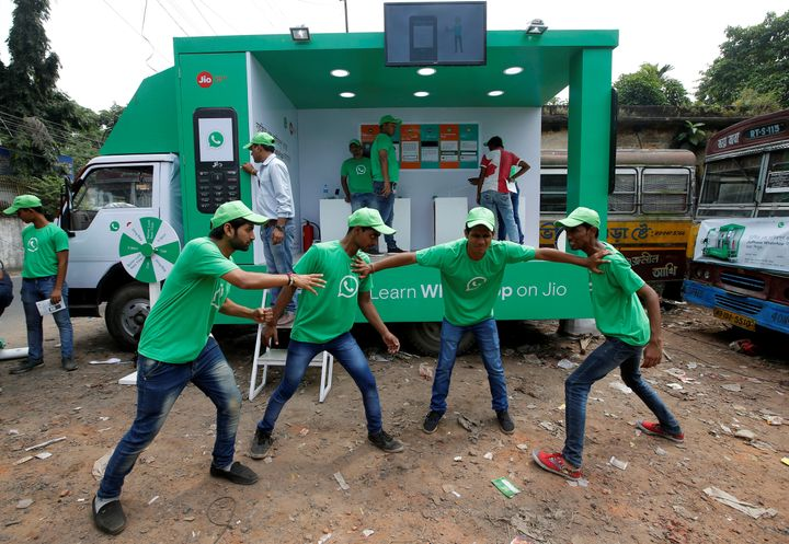 WhatsApp-Reliance Jio representatives perform in a street play during a drive by the two companies to educate users, on the outskirts of Kolkata, India.