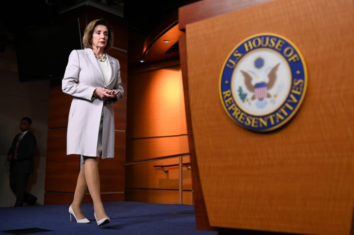 """House Speaker Nancy Pelosi arrives Thursday for a news conference on Capitol Hill. She says House Democrats are on a """"path to"""
