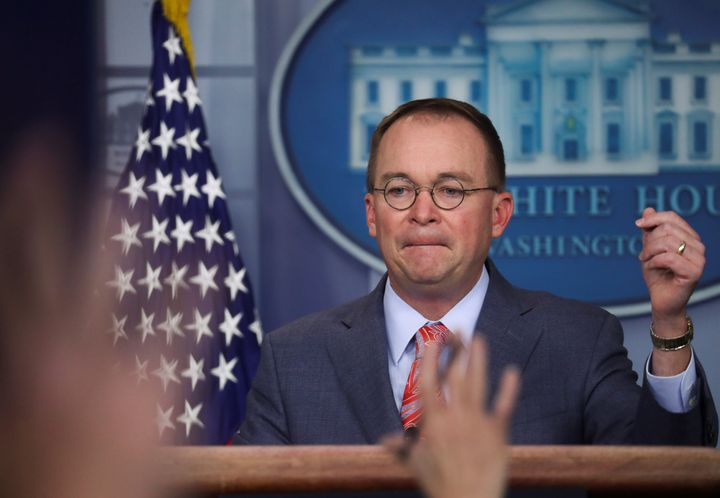 Acting White House chief of staff Mick Mulvaney answers questions from reporters at the White House on Thursday.