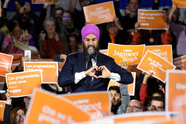 NDP leader Jagmeet Singh smiles as he makes a heart sign while attending a rally with supporters in Montreal...