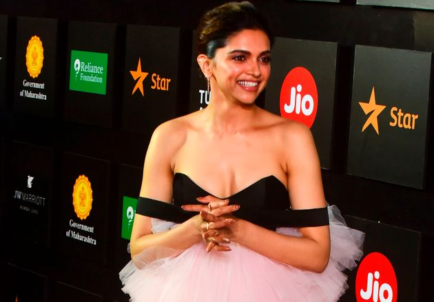 Indian Bollywood actress Deepika Padukone gestures as she attends the opening ceremony of 'Jio MAMI 21st...