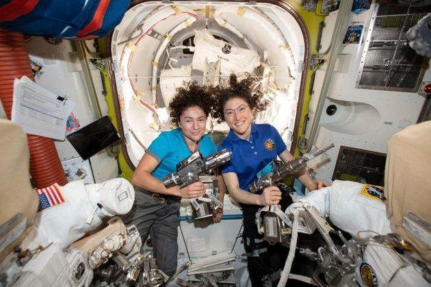 In this photo released by NASA on Thursday, Oct. 17, 2019, U.S. astronauts Jessica Meir, left, and Christina...