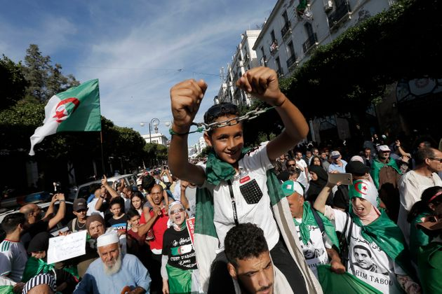 Algerians take part in a protest against the government in Algiers, Algeria, Friday, Oct. 18, 2019. Thousands...