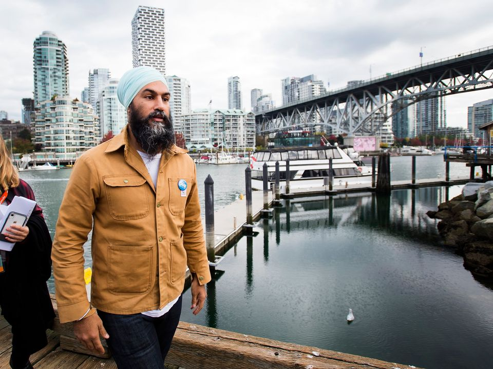 NDP leader Jagmeet Singh leaves the boardwalk after speaking to the media during a campaign stop at Granville...