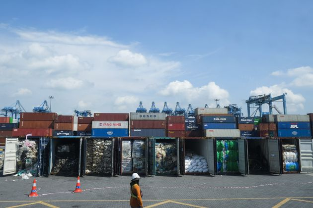 Containers filled with plastic waste waiting to be sent back to their country of origin in Port Klang,...