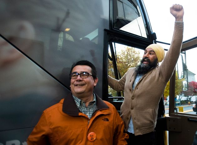 NDP Leader Jagmeet Singh, right, and MP Bob Chamberlin wave to supporters during a campaign stop in Nanaimo,...
