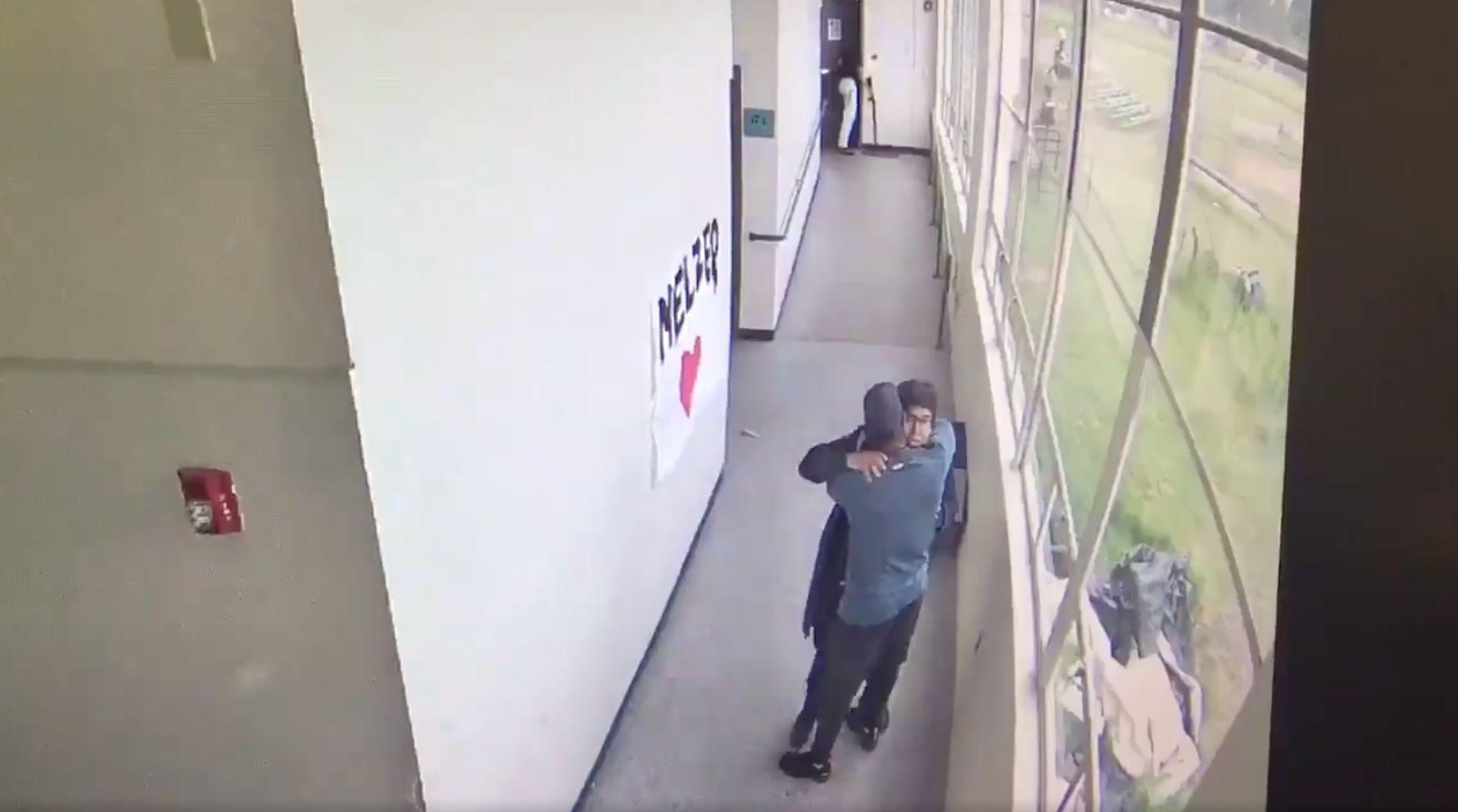 Powerful Video Shows School Coach Comforting Would-Be Gunman