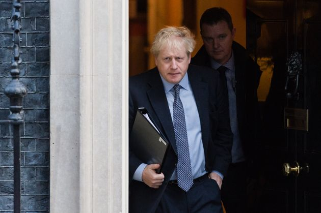 British Prime Minister Boris Johnson leaves 10 Downing Street to deliver a statement to the House of...