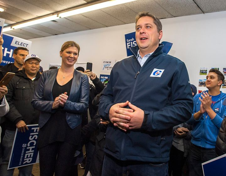 Andrew Scheer and his wife Jill campaign in Toronto on Oct. 19, 2019.
