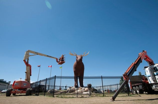 Workers approach Mac the Moose in Moose Jaw, Sask., on June 5,