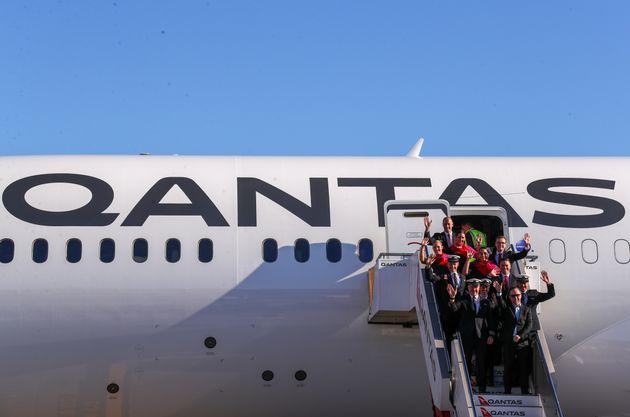 SYDNEY, AUSTRALIA - OCTOBER 20: Alan Joyce, Qantas Group CEO with the flight deck crew and cabin crew...