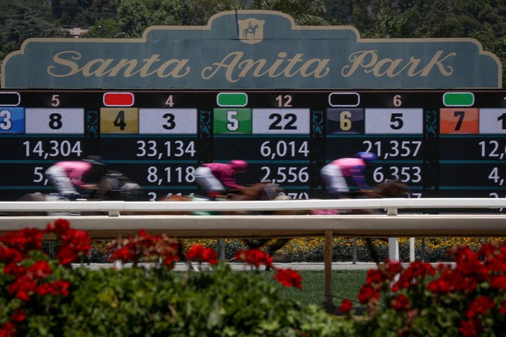 Horses finish a race at the Santa Anita horse racing track on Sunday, June 23, 2019, in Santa Anita, Calif. The park has been