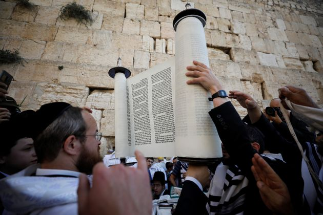 Jewish worshippers take part in the priestly blessing prayer on the holiday of Sukkot, at the Western...