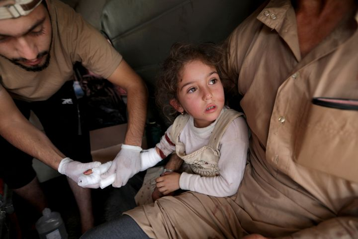 A wounded girl is treated in the town of Tal Abyad, Syria on Sunday.