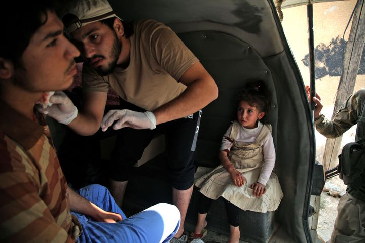 A Syrian man receives treatment on Sunday in the Syrian border town of Tal Abyad which was seized by Turkey-backed forces las