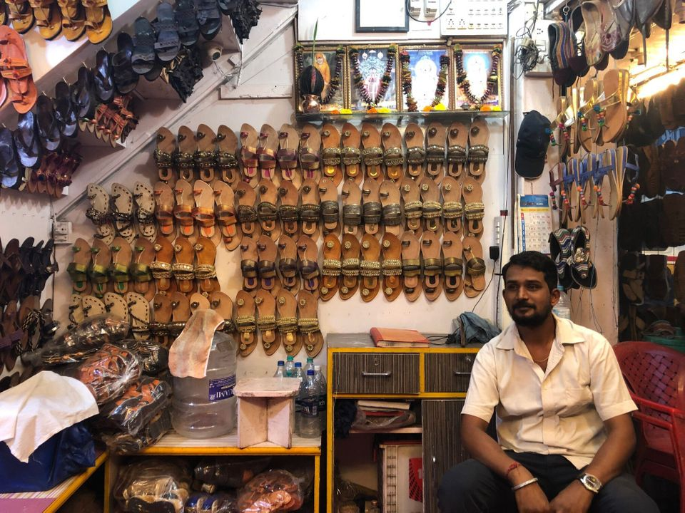 Dattatray Arale at the 'New Utsav' footwear shop in Kolhapur's Shivaji Market.