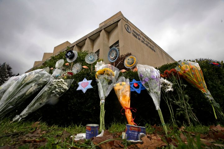 In this Nov. 20, 2018, file photo, a makeshift memorial of flowers rests on bushes outside the Tree of Life Synagogue in Pitt