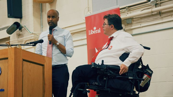 Liberal incumbent Kent Hehr, right, listens to Immigration Minister Ahmed Hussen, left. Hussen was one of several cabinet ministers who visited Calgary Centre before the writ dropped.