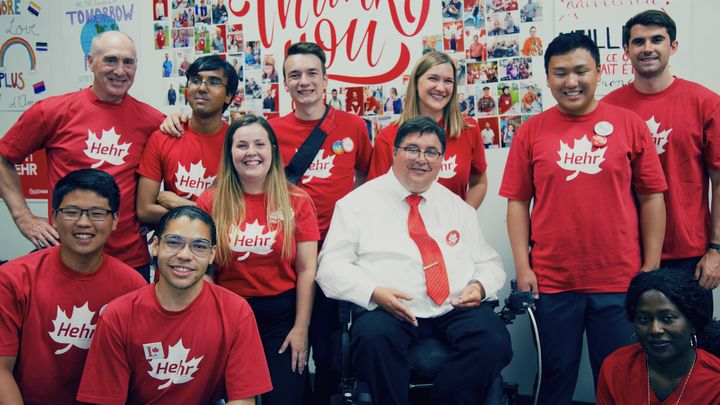 Kent Hehr, the Calgary Centre Liberal incumbent, poses for a photo with volunteers.
