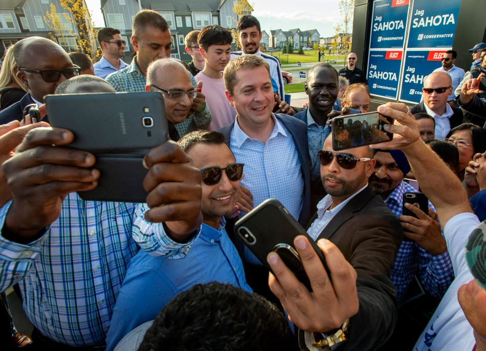 Federal Conservative Leader Andrew Scheer is mobbed by supporters at a campaign event in Calgary on Sept....