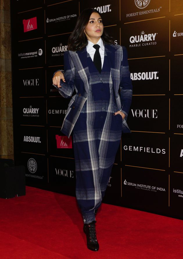 Anushka Sharma in a chequered jumpsuit by Gucci.She won Style Icon Of The