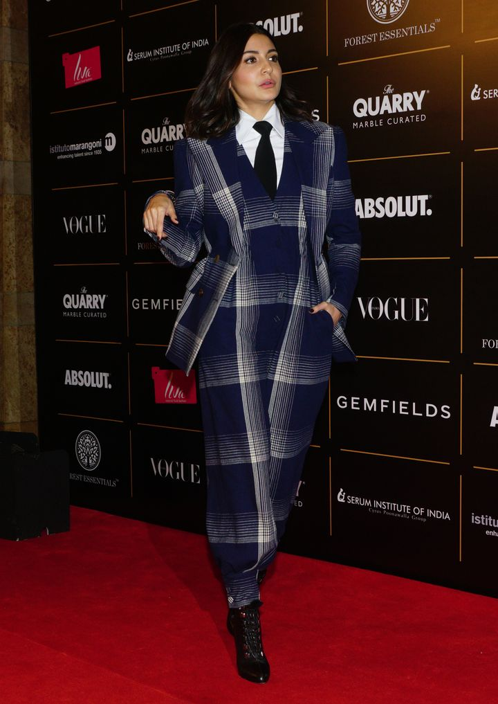 Anushka Sharma in a chequered jumpsuit by Gucci.She won Style Icon Of The Year.
