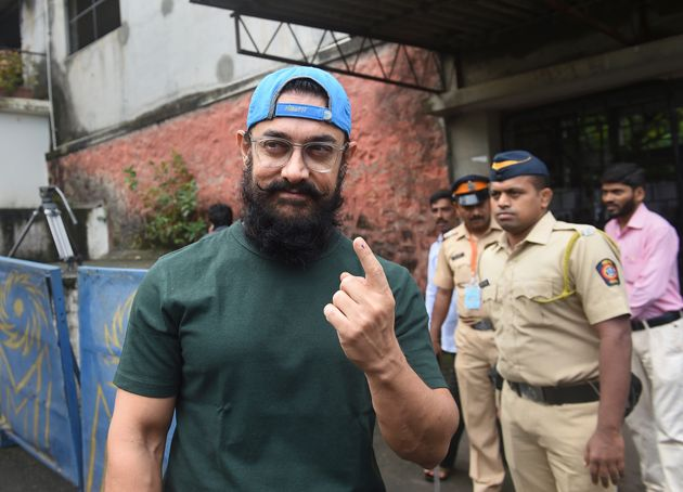 Aamir Khan, along with filmmaker Kiran Rao, came out to cast his vote in St Anne's High School at Pali...