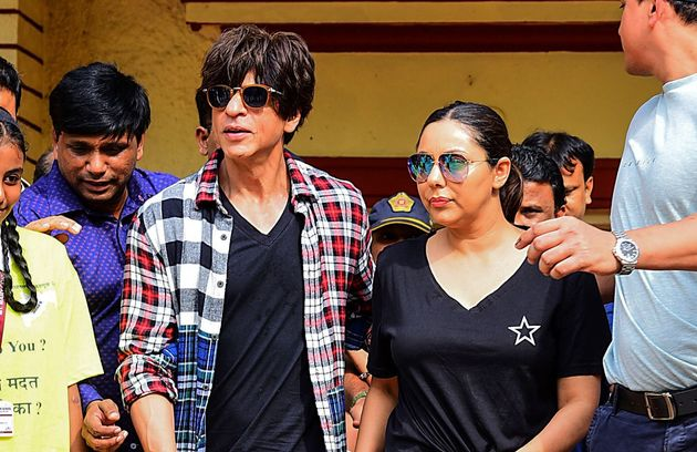 Shah Rukh Khan and Gauri Khan leave after casting their votes at a polling booth in Bandra