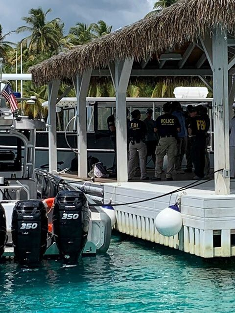 FBI agents at Little St. James Island, one of Epstein's properties, in August following his
