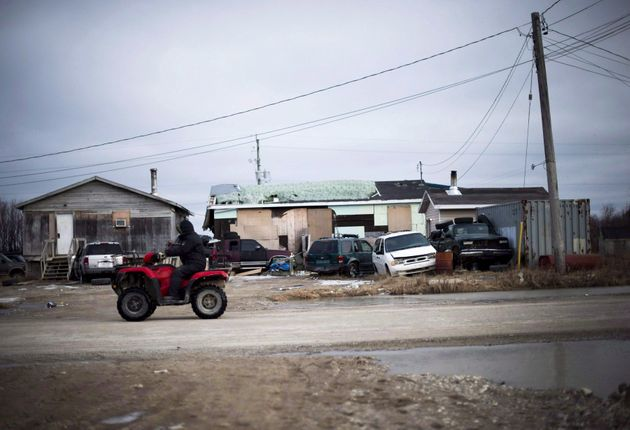 A man rides his ATV in Attawapiskat, Ont., on April 19, 2016. A UN report specifically mentions the northern...