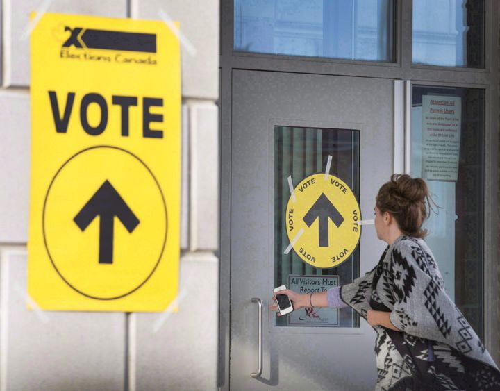 A voter enters a polling station in Vaughan, Ont. during the 2015 election.