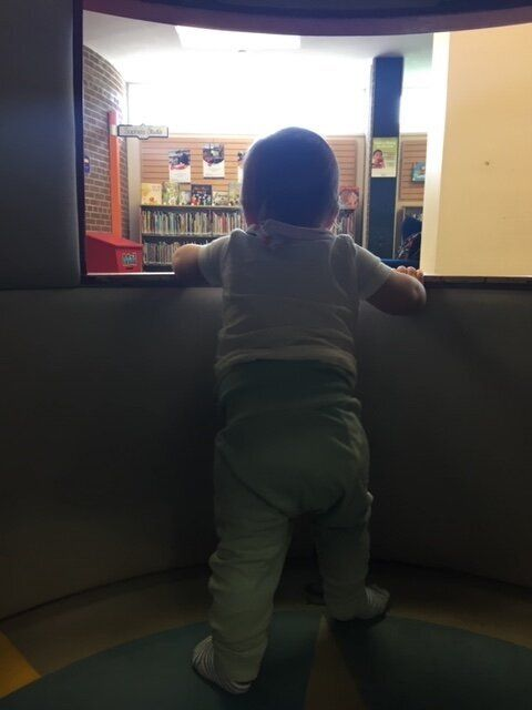 The author's son inside his favourite place, the library's rocket ship.