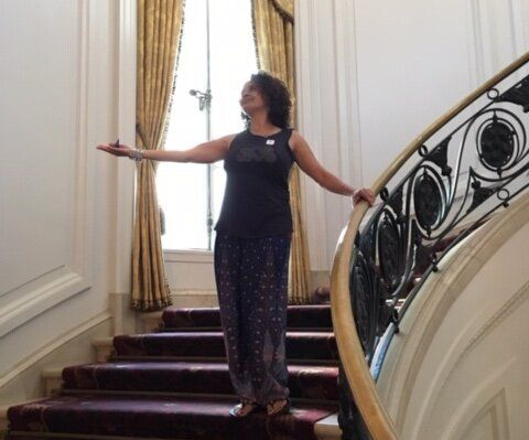 Laura Warrell on a staircase at the Huntington Library, Art Museum and Botanical Gardens in San Marino, California.