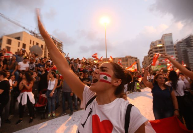 TOPSHOT - Lebanese demonstrators chant slogans as they take part in a rally in the capital Beirut's downtown...