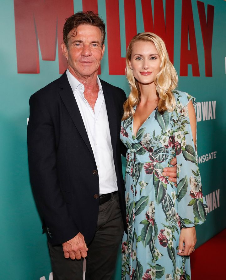 """Dennis Quaid and fiancee Laura Savoie arrive at a screening of """"Midway"""" in Honolulu."""