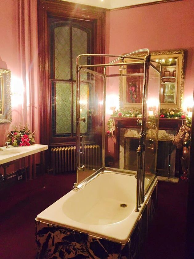 An original bathtub from the Lemp Mansion is preserved in the current