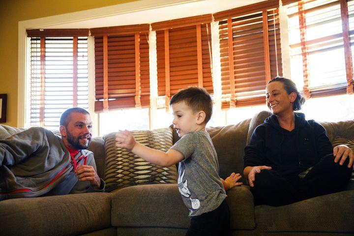 David Kulakowski, 38, and Jessica Kulakowski, 31, watch their 3-year-old son Chase Kulakowski, who has AFM, play in their Dye