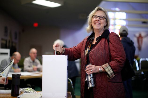 Elizabeth May casts her vote at St. Elizabeth's Parish while in Sidney, B.C., on Oct. 21,