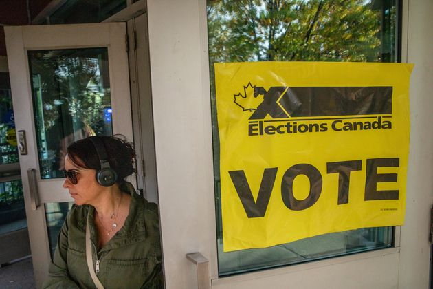 People line up to vote at a polling station in Toronto for the federal election on Oct. 21,