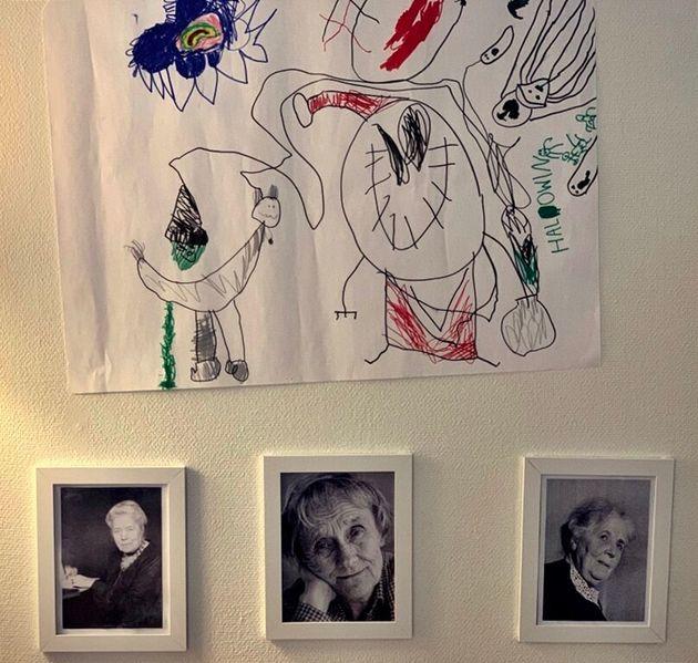 스톡홀름 소재 이갈리아 유치원 벽에, '삐삐'의 작가 아스트리드 린드그렌 등 스웨덴 작가들의 사진과 한 원아의 할로윈 주제 그림이