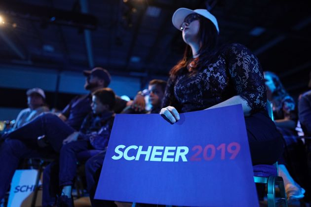 Supporters of Andrew Scheer gather at an election night rally in Regina on Oct. 21,