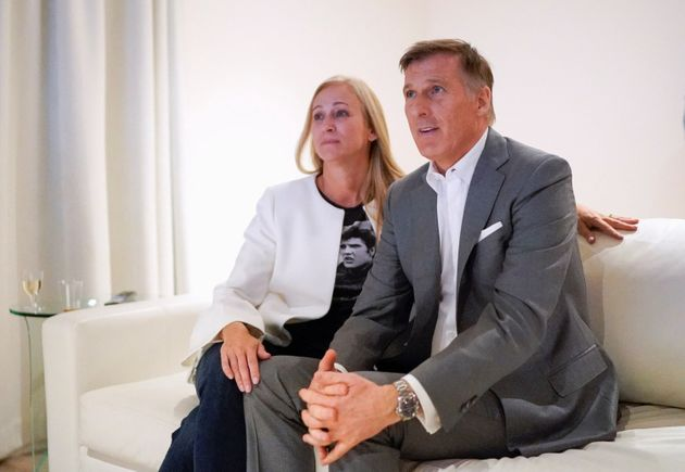 Maxime Bernier watches the results with his wife in Beauceville, Que. on Oct. 21,