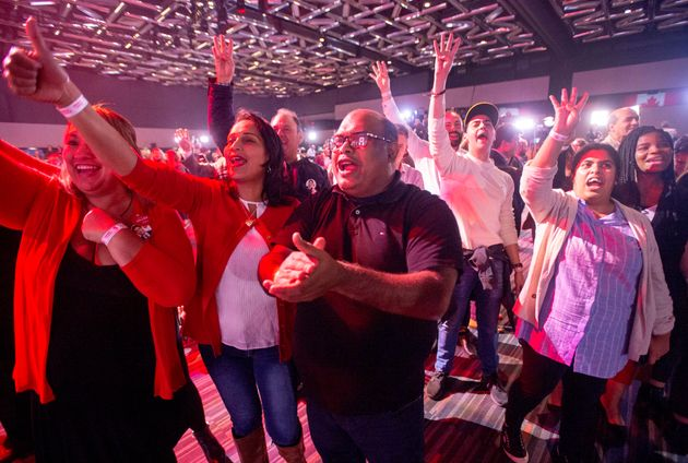 Liberal supporters react to a prediction of a Liberal government at the Liberal election night headquarters...