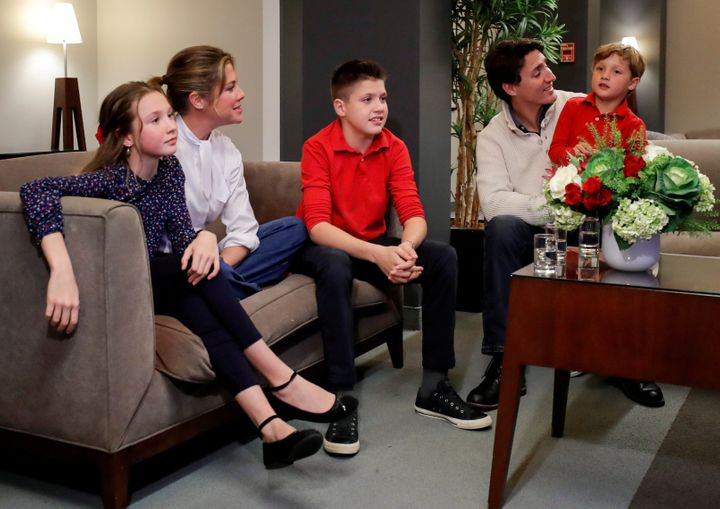 Liberal Leader Justin Trudeau and his wife Sophie Grégoire Trudeau, sons Xavier and Hadrien, and daughter Ella-Grace watch the initial results from the federal election in Montreal on Oct. 21, 2019.