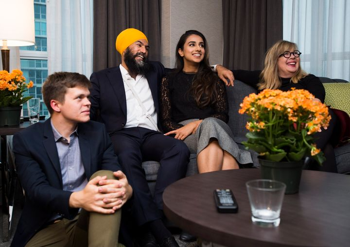 NDP Leader Jagmeet Singh, second left, and his wife Gurkiran Kaur, second right, watch the election results come in at his hotel room in Burnaby, B.C. on Oct. 21, 2019.